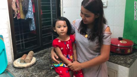 Chit Su Win, wife of Kyaw Soe Oo, with their 3-year-old daughter Moe Thin Wai Zan. They just moved to Yangon from Sittwe to be closer to the jail.