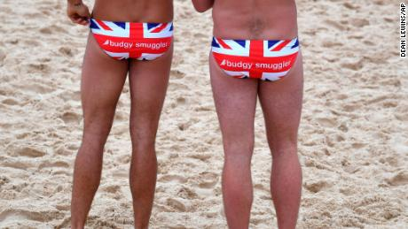 Two men wearing Union Jack 'Budgy Smugglers' as they wait for Britain's Prince Harry at Bondi Beach on October 19.