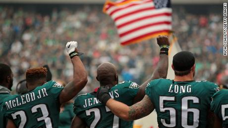 When Malcolm Jenkins raised his fist,  teammate Chris Long offered a public sign of support.