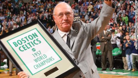Bob Cousy receives a  banner marking the 50th anniversary of the 1957 championship.