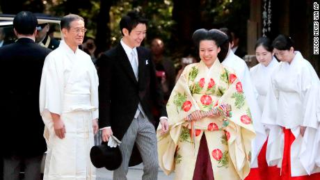 The Japanese princess Ayako, dressed in a traditional ceremonial costume, and the Japanese businessman Kei Moriya, arrive at the Meiji Shrine for their wedding ceremony in Tokyo, on October 29, 2018.