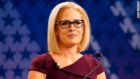 U.S. Rep. Kyrsten Sinema, D-Ariz., goes over the rules in a television studio prior to a televised debate with U.S. Rep. Martha McSally, R-Ariz., Monday, Oct. 15, 2018, in Phoenix. Both ladies are seeking to fill the seat of U.S. Sen. Jake Flake, R-Ariz. who is retiring. The Arizona Senate contest is one of the most closely-watched in the nation.