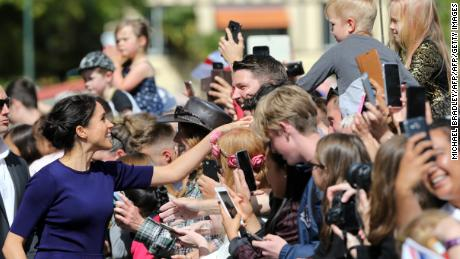 Meghan, Duchess of Sussex, shakes hands with a child during a public walk in the government gardens of Rotorua.