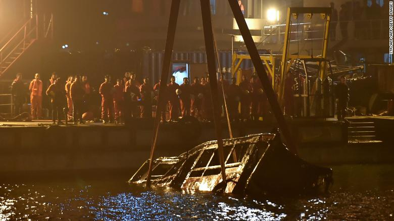 A crane salvages the wreckage of a bus after it plunged off a bridge into the Yangtze River in China's southwestern Chongqing early