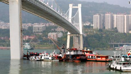 Rescuers conduct search and rescue operation at the site where a bus has plunged off a bridge into the Yangtze River in Wanzhou on October 28
