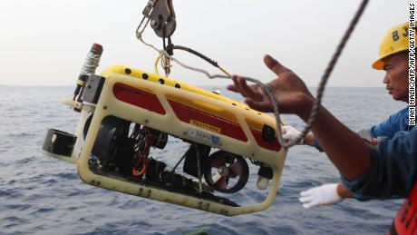 A remotely operated underwater vehicle is prepared for a search of Flight 610's cockpit voice recorder.