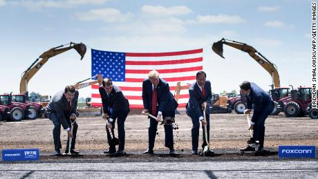 TOPSHOT - Wisconsin Governor Scott Walker (2nd L), US President Donald Trump (C), Foxconn Chairman Terry Gou (2nd R), Speaker of the House Paul Ryan (R) and an unidetified official (L) participate in a groundbreaking for a Foxconn facility at the Wisconsin Valley Science and Technology Park on June 28, 2018 in Mount Pleasant, Wisconsin.