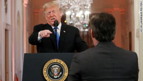 "President Donald Trump points at CNN's Jim Acosta and accuses him of ""fake news"" while taking questions during a news conference following Tuesday's midterm congressional elections at the White House in Washington, D.C. Wednesday, November 7, 2018."