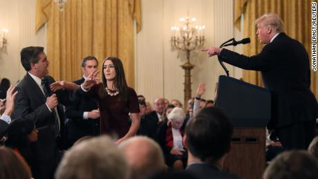 A White House staff member grabbed a microphone held by Jim Acosta when he questioned Trump.