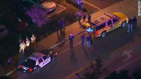 In this image made from aerial video police vehicles line a road in the vicinity of a shooting in Thousand Oaks California early Thursday Nov. 8 2018. Authorities say there were multiple injuries _ including one officer _ after a man opened fire in S