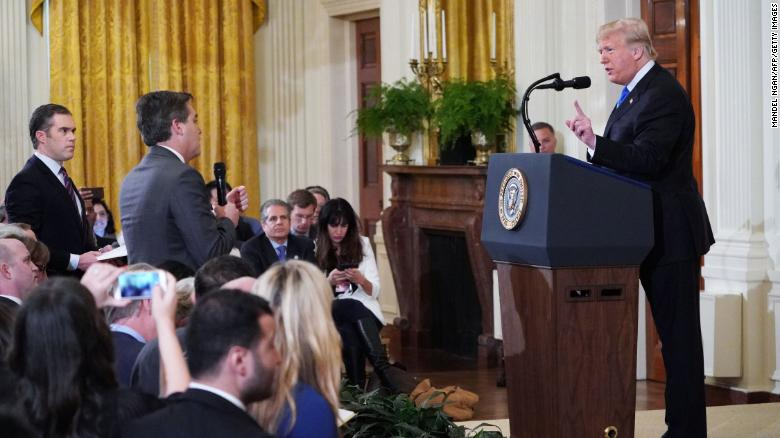 US President Donald Trump gets into a heated exchange with CNN chief White House correspondent Jim Acosta as NBC correspondent Peter Alexander looks on during a post-election press conference in the East Room of the White House in Washington