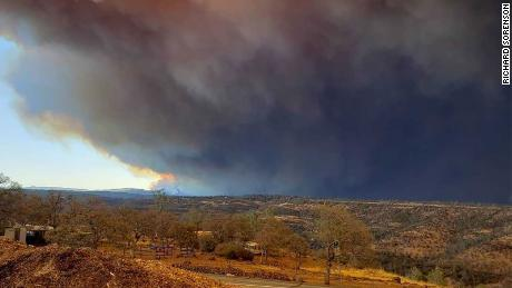 Homes, hospital burn as thousands flee California wildfire