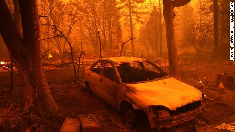 California city reeling from mass shooting now under siege from raging wildfires
