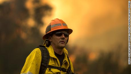 Los Angeles County firefighters are battling the Woolsey fire  near Malibu.