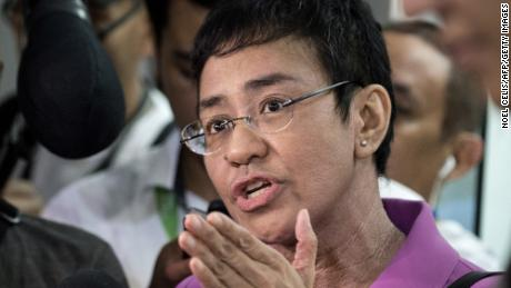 Maria Ressa speaks to the media as she arrives at the National Bureau of Investigation (NBI) headquarters in Manila on January 22, 2018.