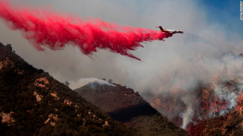 Authorities search for missing as California wildfires rage on