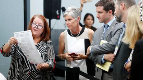 Judge Deborah Carpenter-Toye, left, Canvassing Board member, shows political observers a test ballot that needs replacing at the Broward County Supervisor of Elections office, Monday, Nov. 12, 2018, in Lauderhill, Fla. (AP Photo/Wilfredo Lee)