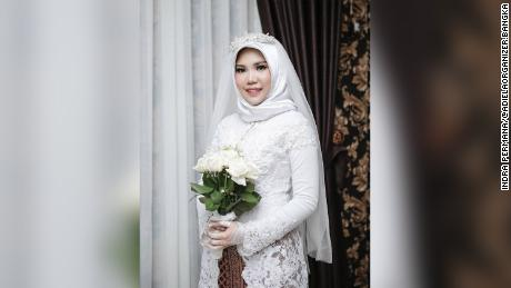 "Pratama asked his bride-to-be to wear a white kebaya, a traditional blouse, and hold a bouquet of ""fresh white roses."""