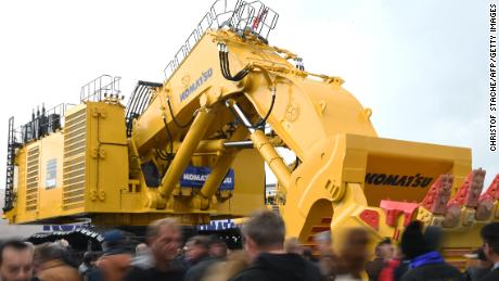 A Komatsu excavator displayed at a construction trade fair in Munich in 2016. The machinery maker told CNN that tariffs could cost its business about $  35 million.