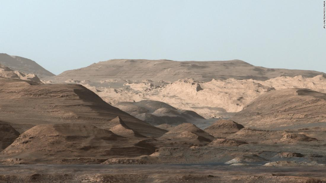 This composite image, looking toward the higher regions of Mount Sharp, was taken in September 2015 by NASA's Curiosity rover. In the foreground is a long ridge teeming with hematite. Just beyond is an undulating plain rich in clay minerals. And just beyond that are a multitude of rounded buttes, all high in sulfate minerals. The changing mineralogy in these layers suggests a changing environment in early Mars, though all involve exposure to water billions of years ago.