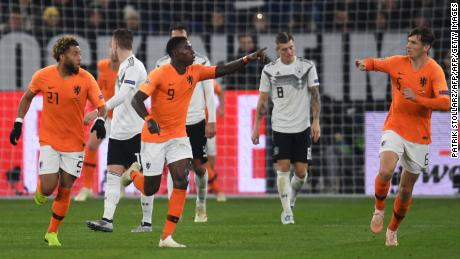 Dutch forward Quincy Promes celebrates after scoring his team's first goal on the 85th minute