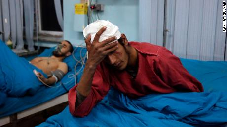 An injured men receives treatment at a hospital after the suicide bombing in Kabul.