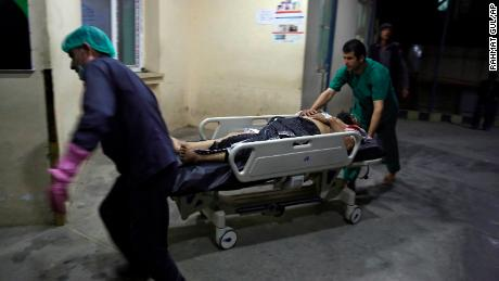 A man injured in the suicide bombing in Kabul is brought into a hospital.
