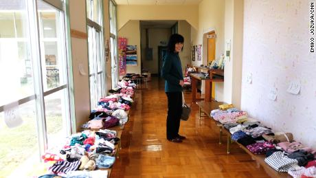 Nobue Sasaki stands in the hallway of the Nagi Child Home.