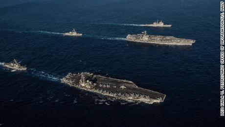 Ships attached to the Ronald Reagan Carrier Strike Group and John C. Stennis Carrier Strike Group transit the Philippine Sea during dual carrier operations.