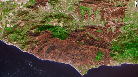 The burned areas from the Woolsey Fire are brown; unburned vegetation is green. The light gray or white areas are buildings, roads and other developed areas.