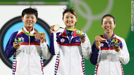Team Chinese Taipei celebrate with their Bronze medals after finishing third in the Women's Team Finals at the Rio 2016 Olympic Games on August 7, 2016.