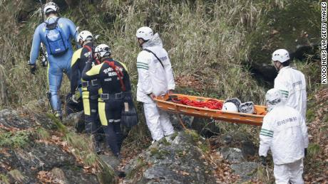 Divers and rescue workers search the Gokase River in Takachiho on November 27, 2018.