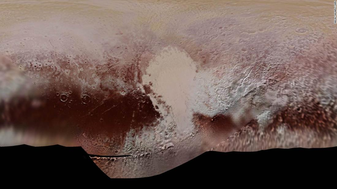 """A detailed color map of Pluto taken during the NASA spacecraft's close flyby of Pluto in July 2015. The mosaic shows how Pluto's large-scale color patterns extend beyond the hemisphere facing New Horizons at closest approach, which were imaged at the highest resolution. North is up; Pluto's equator roughly bisects the band of dark red terrains running across the lower third of the map. Pluto's giant, informally named Sputnik Planitia glacier -- the left half of Pluto's signature """"heart"""" feature -- is at the center of this map."""