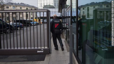 A police officer passes a gate outside the headquarters of Deutsche Bank on Thursday.