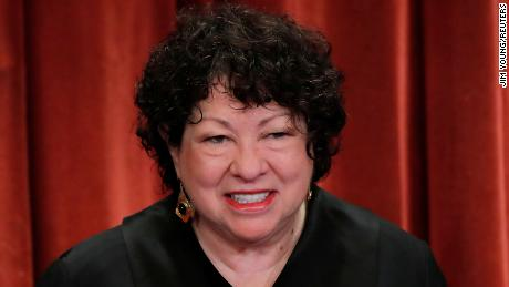 NOI. Supreme Court Associate Justice Sonia Sotomayor smiles during a group portrait session for the new full court at the Supreme Court on Nov. 30, 2018 a Washington, DC.