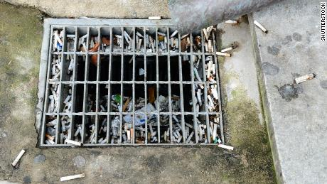 Cigarette butts collect in drains and are washed into waterways.