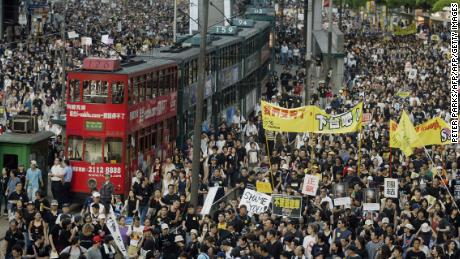Trams sit stranded as hundreds of thousands of people block the streets in a huge protest march against a controversial anti-subversion law known as Article 23 in Hong Kong in 2003.