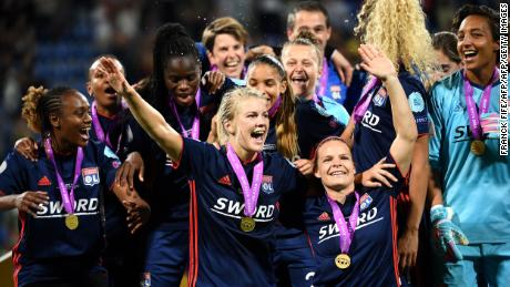Ada Hegerberg celebrates Lyon's third successive Champions League title after a 4-1 in over Wolfsburg