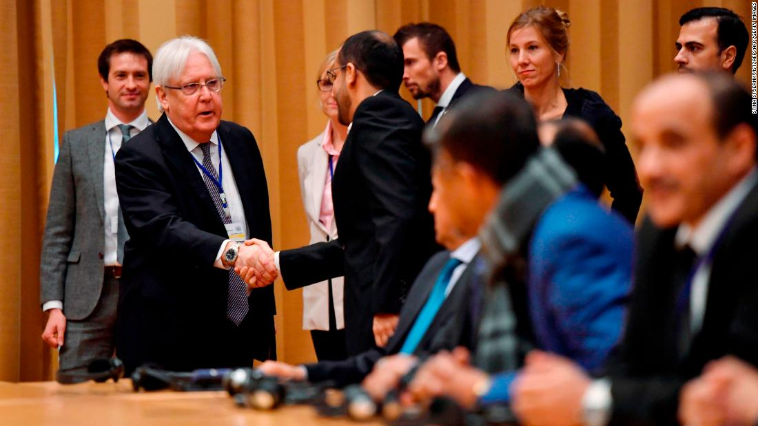 UN Special Envoy to Yemen Martin Griffiths shakes hands with Yemeni delegates during the opening press conference of the Yemeni peace talks at Johannesberg castle in Rimbo, Sweden.