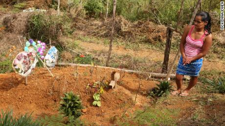 Delmi Amparo Hernández buried her husband in the earth he used to till.