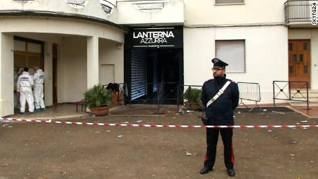 Forensic teams and police cordoned off the entrance of the Lanterna Azzurra nightclub on Saturday.