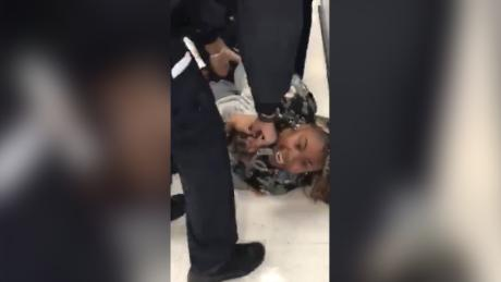 NYPD officers pried a 1-year-old child from his mother's arms in a disturbing video that is now under review.