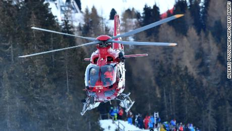 A rescue helicopter transports Switzerland's Marc Gisin to hospital after his horror crash in the World Cup men's downhill at Val Gardena.