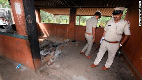 Indian policeman inspect the kitchen of a temple on Saturday after the incident.