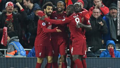 Liverpool's Senegalese striker Sadio Mane celebrates with his teammates after scoring the opener against Manchester United at Anfield.