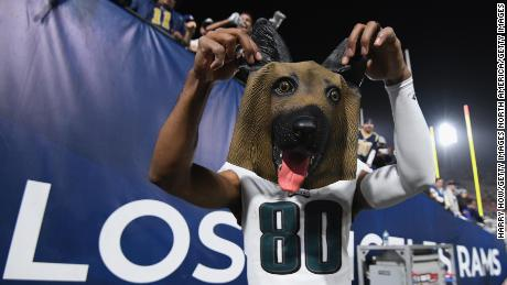 Jordan Matthews of the Philadelphia Eagles holds up a dog mask received from a fan after the team's big 30-23 win over the Los Angeles Rams.
