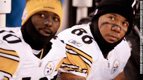 Hines Ward and Santonio Holmes of the Pittsburgh Steelers look on from the bench during a loss to the Browns in 2009.