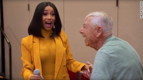 Cardi B reacts with surprise after a man asks her out at a senior center in Los Angeles.