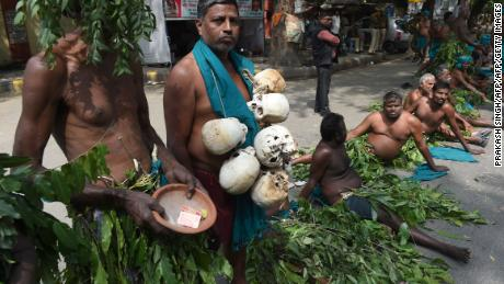 Indian farmers from the southern state of Tamil Nadu wear tree leaves and hold symbolic skulls as they take part in a protest in New Delhi on March 16, 2017.