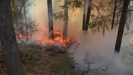 Utility company's role in wildfires under scrutiny